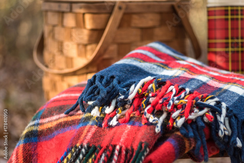 фотографія  Plaid wool blanket and retro picnic items - outdoor recreation concept