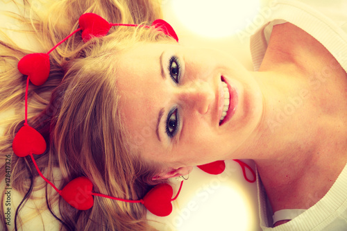 Girl with little red hearts.