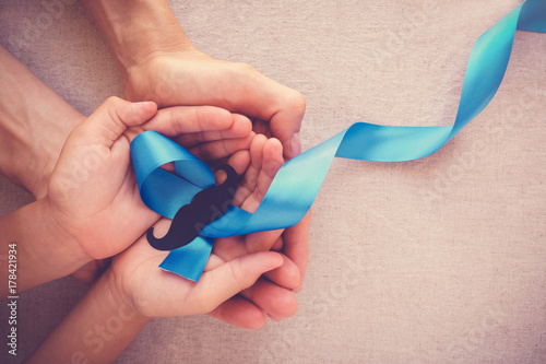 Photo  Adult and child hands holding Light blue ribbons with mustache , Prostate Cancer