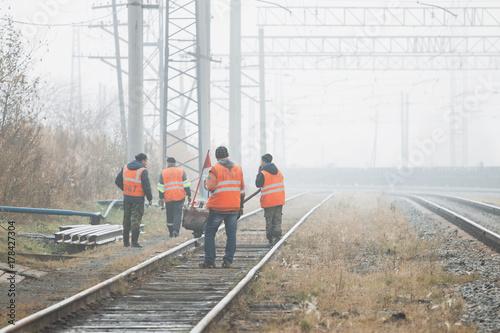 Railroad workers maintaing railways