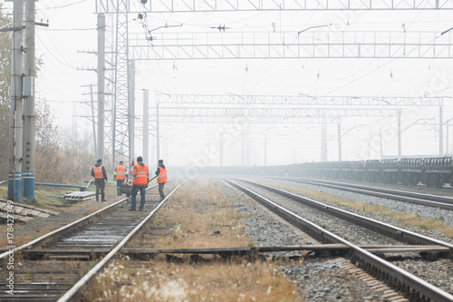 Railroad workers maintaing railways