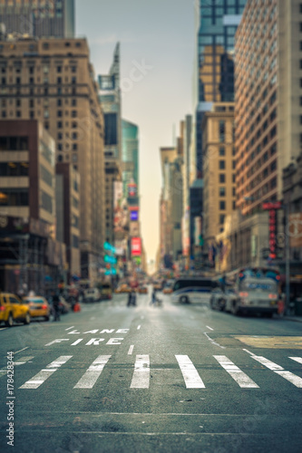 Photo sur Toile New York TAXI Tilt-shift view of a crosswalk in a New-York city avenue, USA