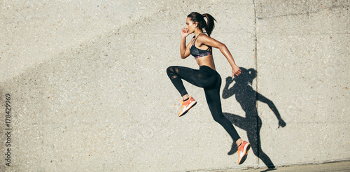 Leinwand Poster Woman doing fitness exercise outdoors