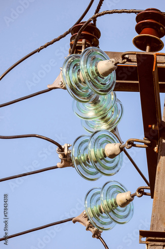 electricity garlands of insulators with electric wires on a top steel mast  support