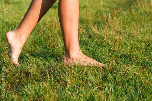 female walking on green grass barefoot Canvas Print