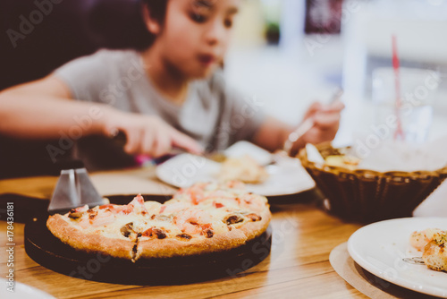 a girl eatting pizza Canvas Print