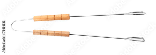 Cuadros en Lienzo Barbecue tongs with wooden handle on white background