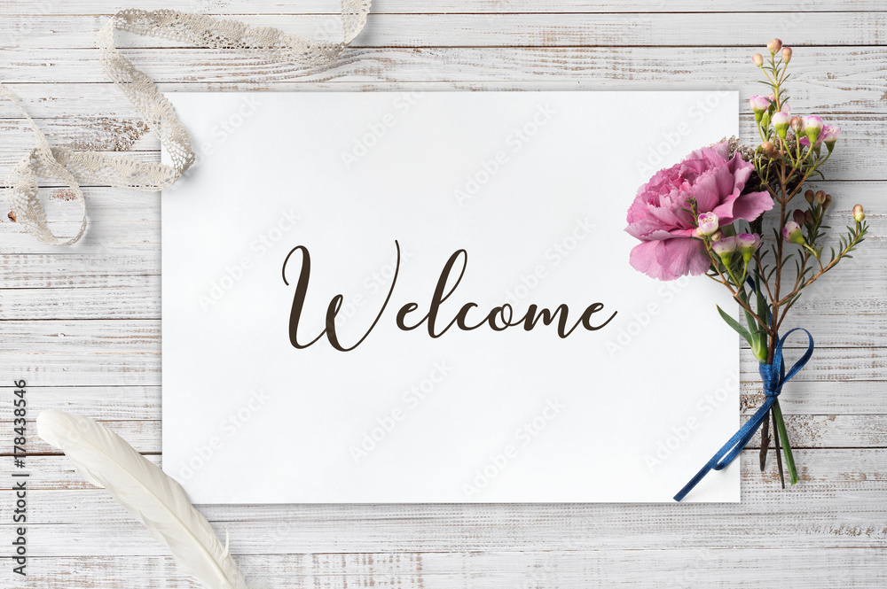Valokuva  Welcome  - calligraphy on paper sheet with decorative items