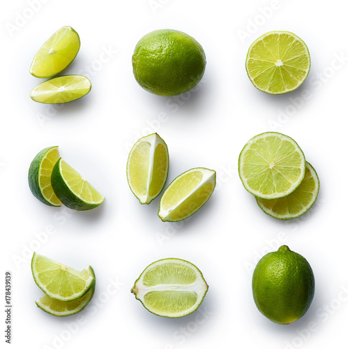 Valokuvatapetti Fresh lime isolated on white background
