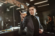 successful client of barbershop/ Businessman in suit with a glass of whiskey in barbershop
