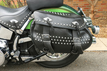 A Black Leather Motorcycle Saddlebag Pannier With Studs, Fringes And Buckles