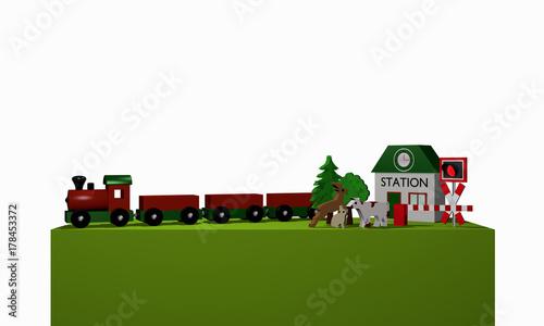 Photo Stands Turquoise Holzspielzeug für eine Eisenbahn mit Text Bahnhof in englisch auf einem grünen Podest