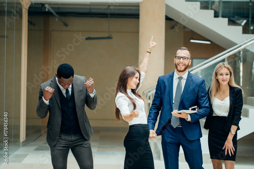 Fototapety, obrazy: Business team celebrating a triumph with arms up