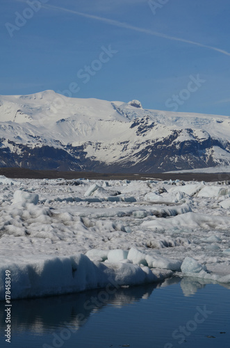 Landscape of glaciers and icecaped mountain in the background
