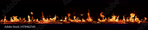 Poster Fire / Flame Horizontal fire flames with dark background