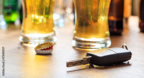 Fotografie, Obraz Drinking and driving. Car key on a wooden bar counter