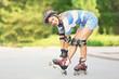 Leinwanddruck Bild - Young woman on roller skates in summer park