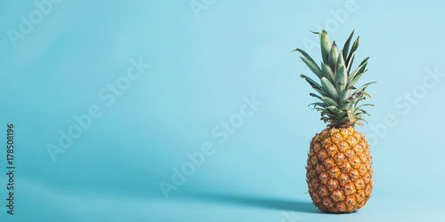 Whole pineapple on a bright blue background