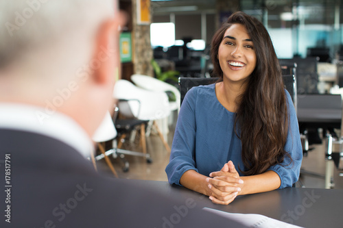 Young female candidate laughing at job interview Wallpaper Mural