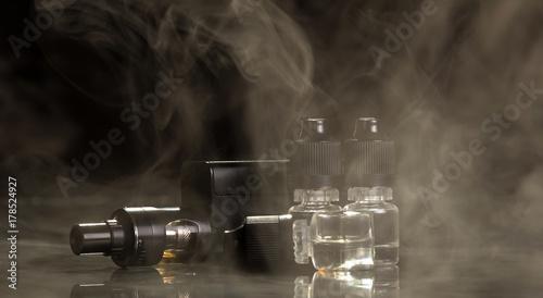 Fototapety, obrazy: Steam e-cigarette and liquid isolated on black