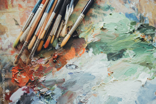 Colorful artist brushes and paint. Fototapet