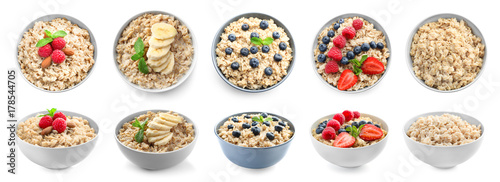 Foto Bowls of oatmeal with berries and fruits on white background