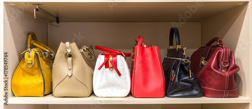 Photo collection of handbags in woman`s closet