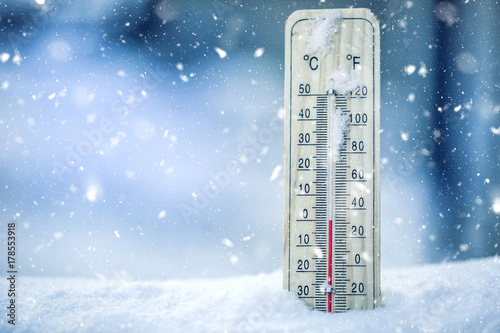Thermometer on snow shows low temperatures - zero Fototapeta