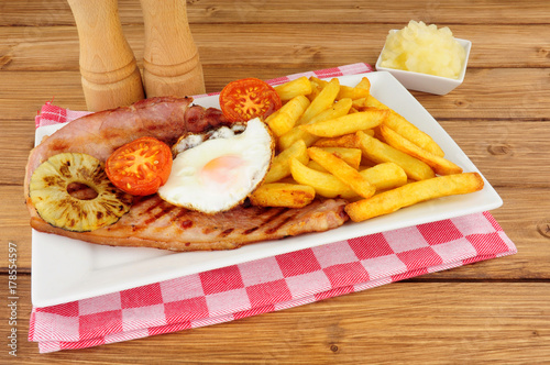 Grilled gammon egg and chips meal Canvas Print