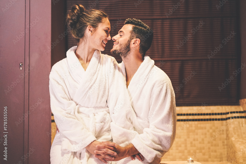 Fototapeta Loving couple story having a passion moment in their vacation honeymoon - Embrace romantic lovers kissing - Romance, intimate, relationship concept - Soft focus on male face