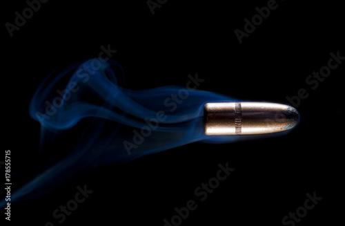 Valokuvatapetti Bullet and blue smoke