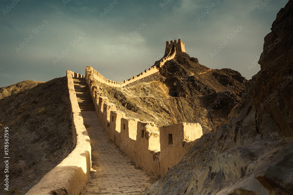 Sunset over Jiayuguan Great Wall of Ming Dynasty, Gansu China.