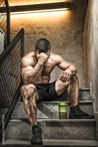 Bodybuilder resting after hard workout Canvas Print