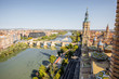 Aerial cityscape view on Elbe river with stone bridge and church of Our Lady in Zaragoza city in Spain