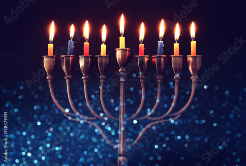 jewish holiday Hanukkah background with menorah (traditional candelabra) and burning candles