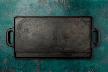 Empty Cast Iron Frying Board. Food Cooking Background. Copy Space