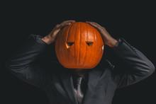 Man With A Pumpkin Head Dresse...