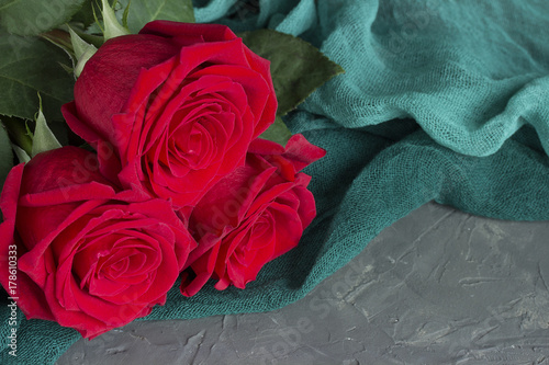 three-red-roses-on-gray-concrete