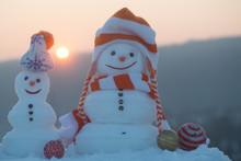 Snowmen In Clothing On Mountai...