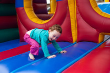 Laughing Toddler On Trampoline