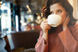 canvas print picture - woman drinking coffee in a cafe