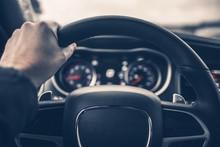 Hand On Car Steering Wheel