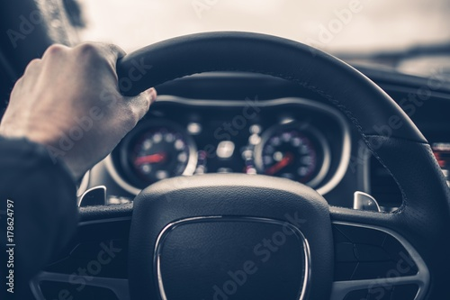 Tablou Canvas Hand on Car Steering Wheel