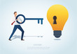 man holding the big key with keyhole on the lightbulb, concept of creative thinking vector