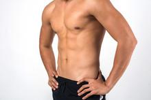 Muscular Man Showing Six Pack ...