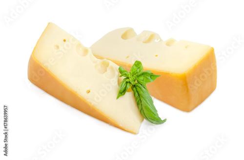 Fototapeta Dwa kawałki szwajcarskiego sera z gałązką bazylii