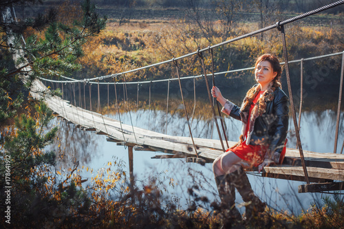 Papiers peints Cappuccino Woman on the suspension bridge in autumn