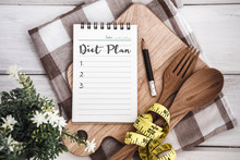 Line Notepad With Diet Plan List Text  On Chopping Board With Wooden Fork And Spoon And The  Measuring Tape On White Table , Recipes Food Or Diet Plan For Healthy Habits Shot Note Background Concept