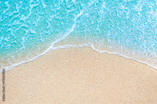 Poster Beach Sea Beach and Soft wave of blue ocean. Summer day and sandy beach background.
