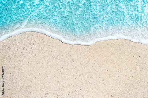 Stickers pour portes Eau Sea Beach and Soft wave of blue ocean. Summer day and sandy beach background.